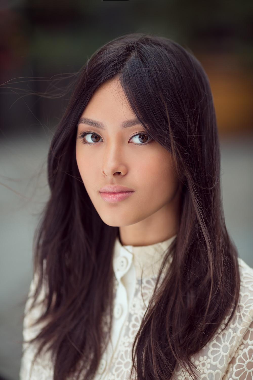 Wanita asia dengan poni panjang model rambut layer