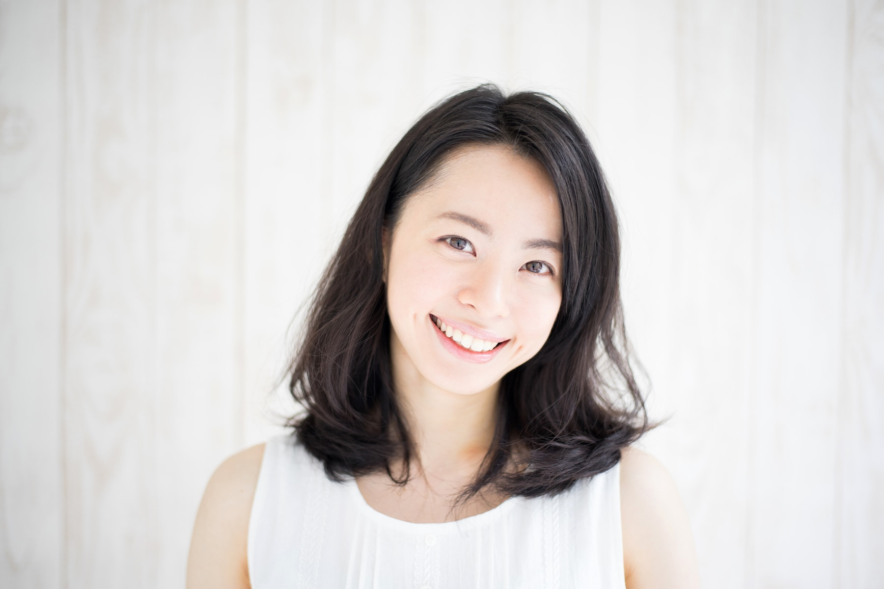 Wanita asia dengan model rambut sebahu untuk wajah bulat