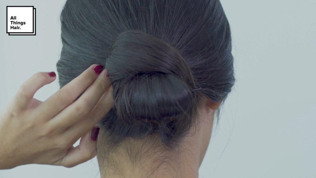 Sleek low knot a la Anna Oktarina.