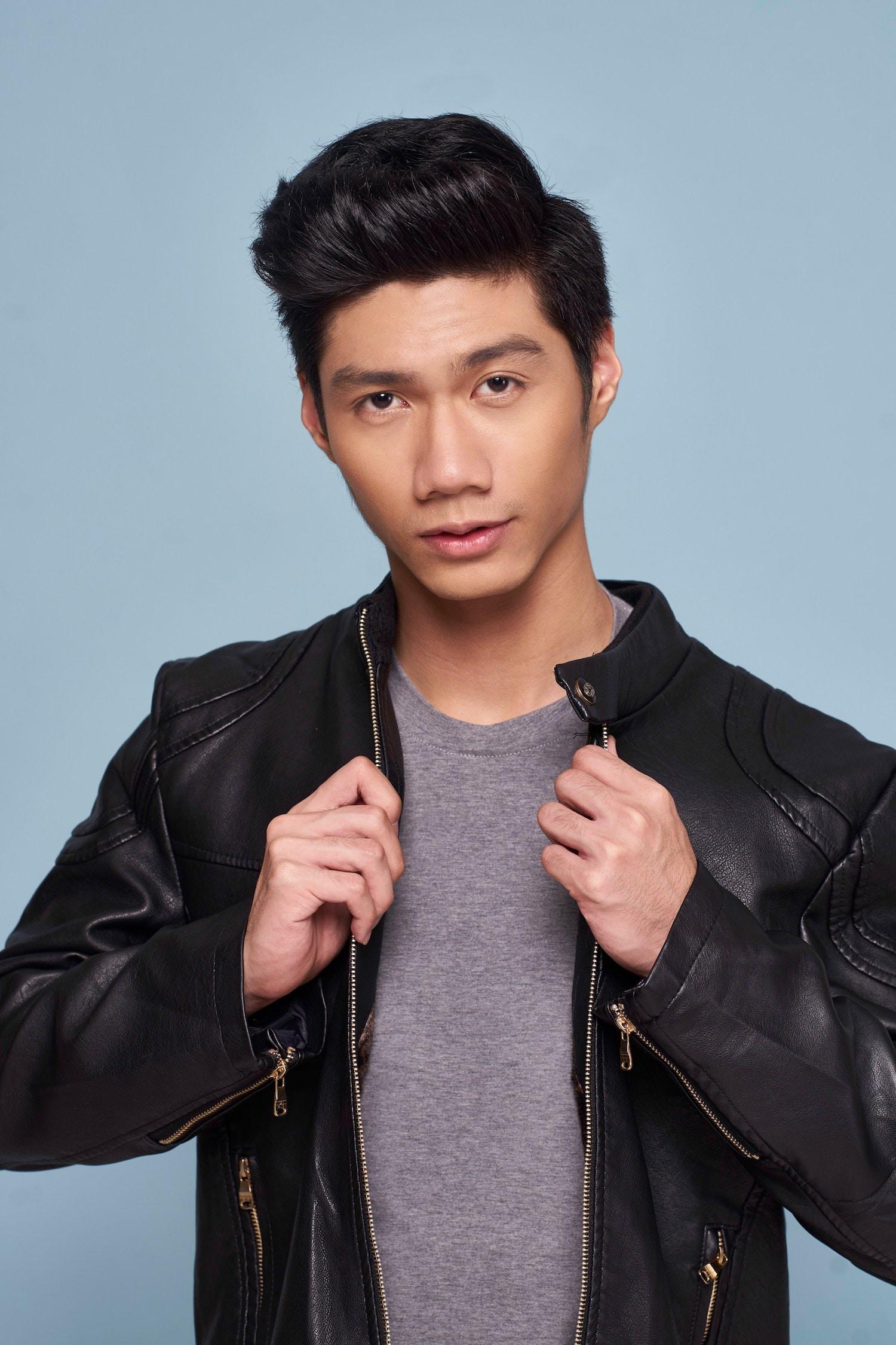 Pria Asia dengan rambut quiff.