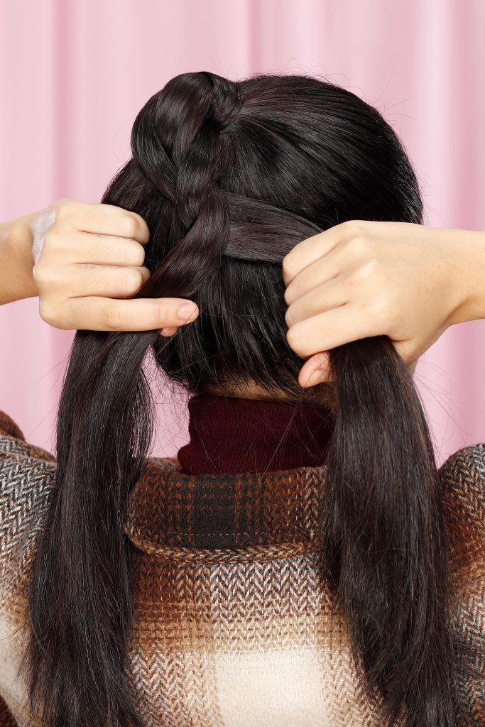 wanita asia dengan rambut kepang ponytail