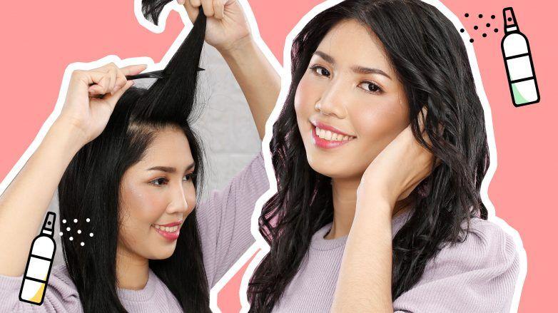 wanita asia dengan rambut panjang sedang menggunakan hairspray
