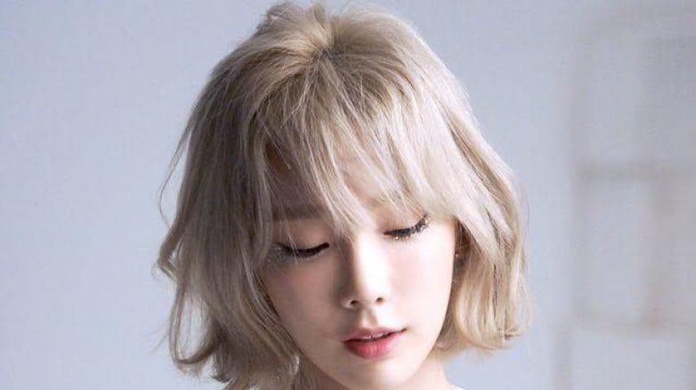 Taeyeon dengan warna rambut blonde ash hasil bleach