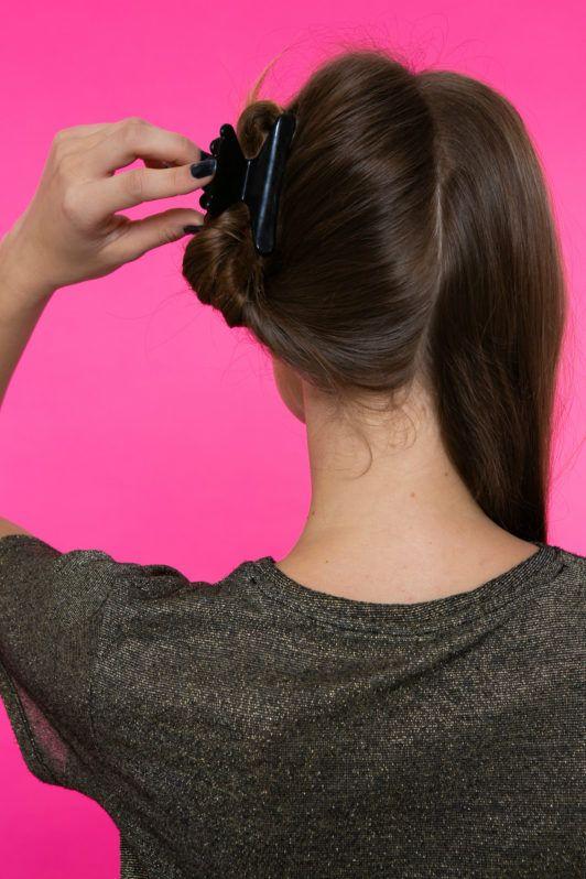 dos rodetes altos pelo castaño mujer