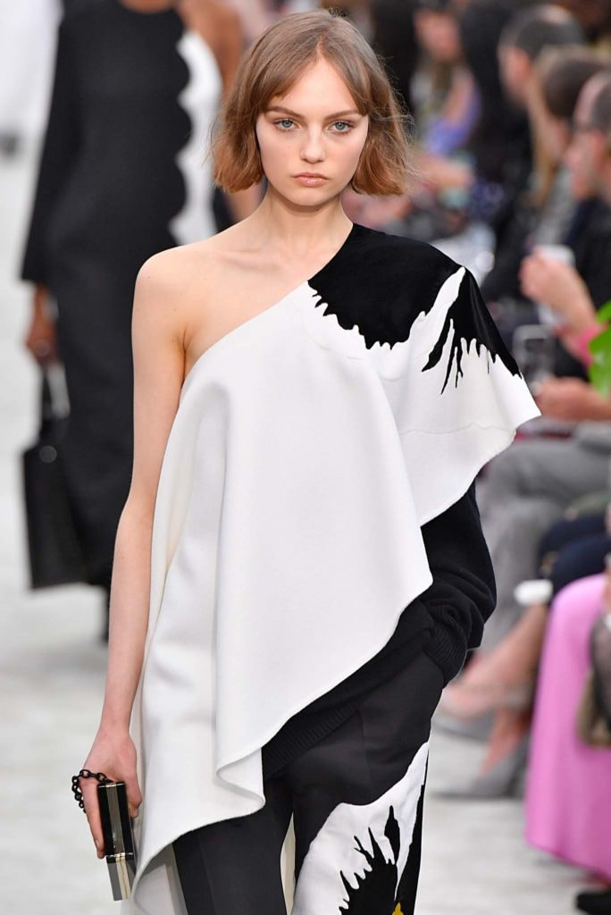 New hairstyle: Model with dark blonde bob and centre part bangs on Valentino FW18 runway wearing a one shoulder dress.