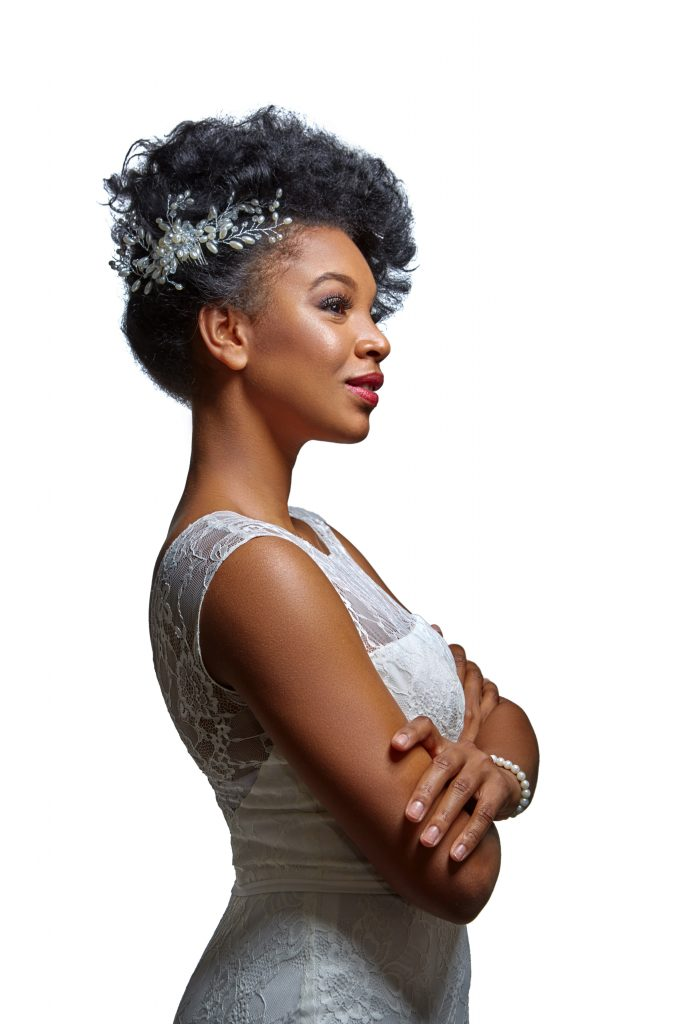 relaxed natural hair wedding hairstyle with accessory