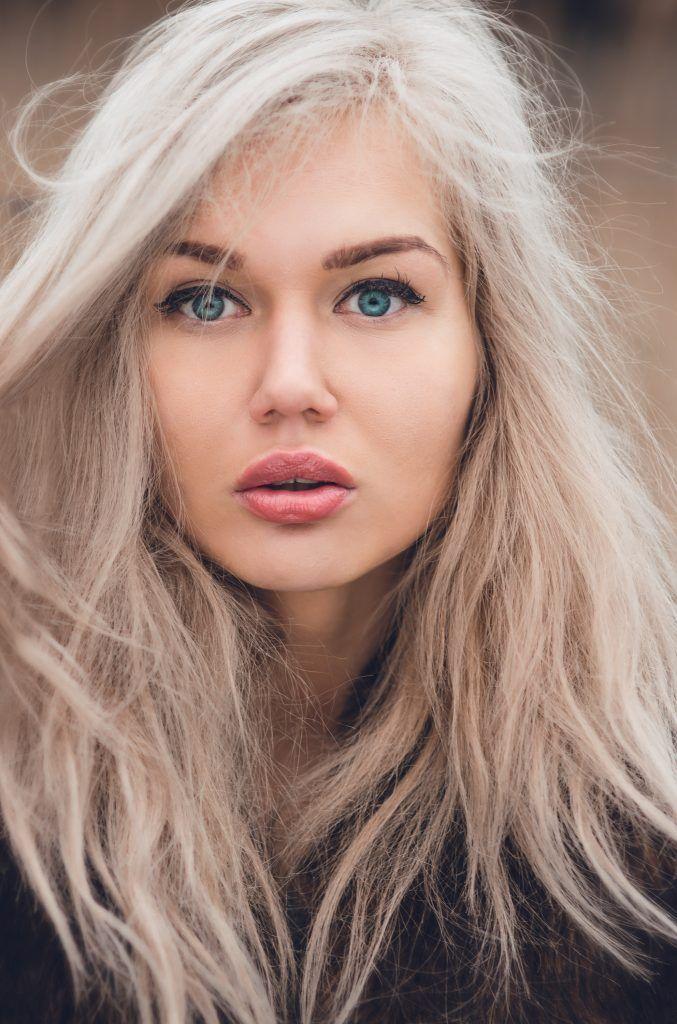 woman with blonde hair blue eyes straight hair