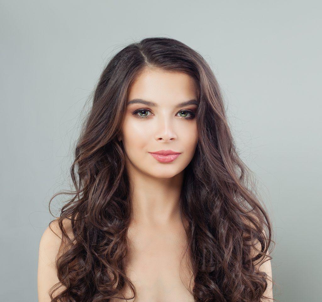 woman with dark brown ash brown long hair wavy
