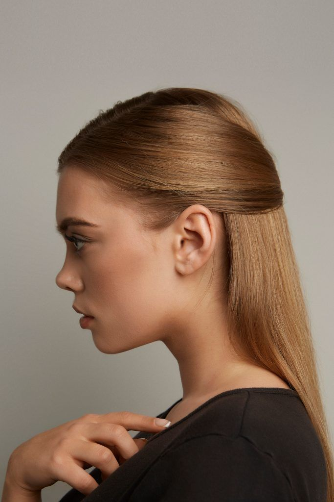 woman with half up hairstyle dark blonde hair