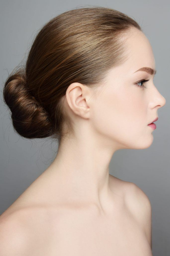 woman with a slicked back bun hairstyle