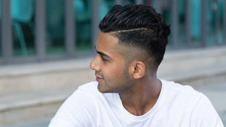man with neat hair, fade hairstyle and side path