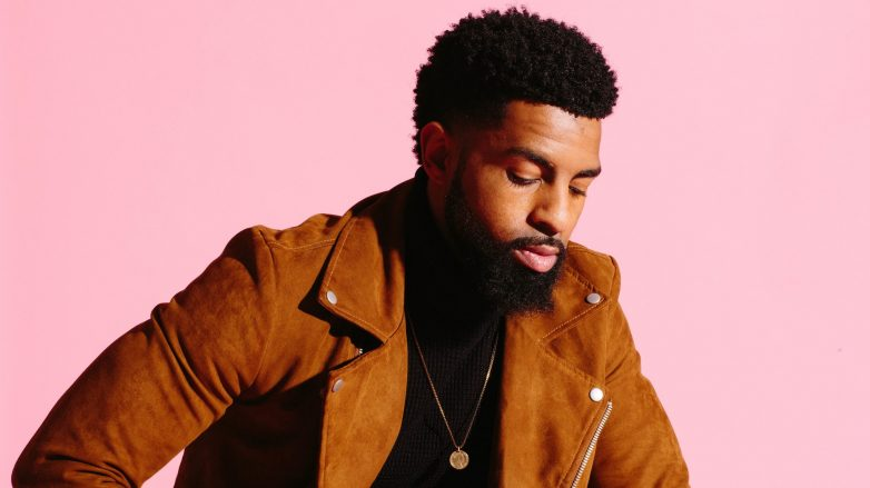 man with natural hair and a thick, full beard