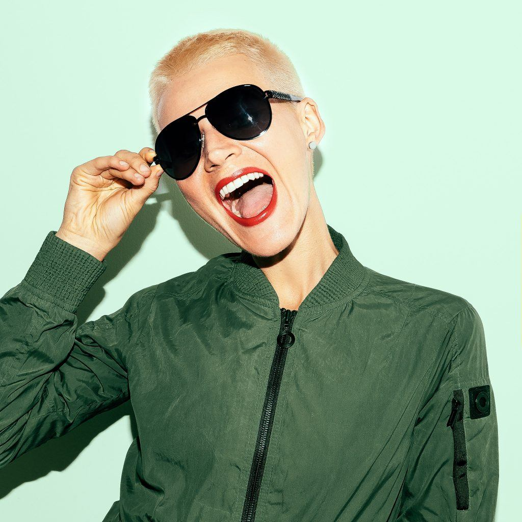 woman with a blonde buzz cut hairstyle