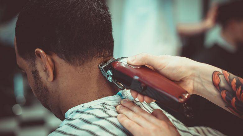 man in a barbershop getting his hair cut