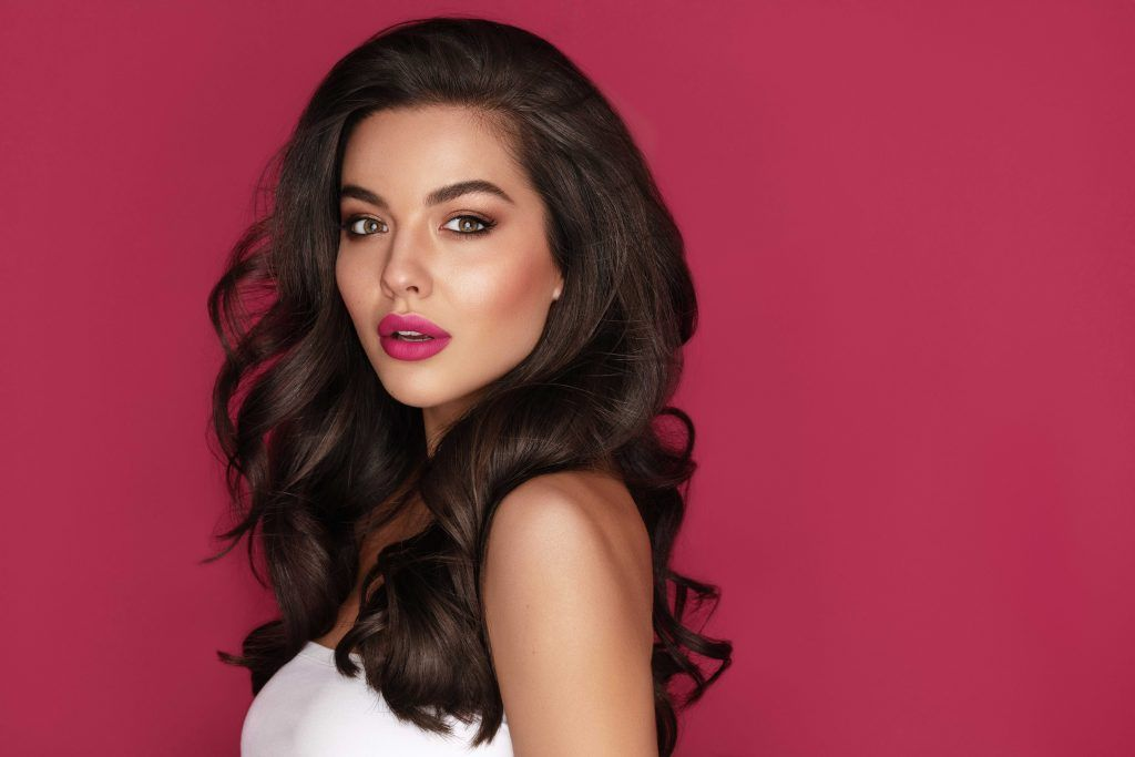 glam winter trend: woman with voluminous brown hair