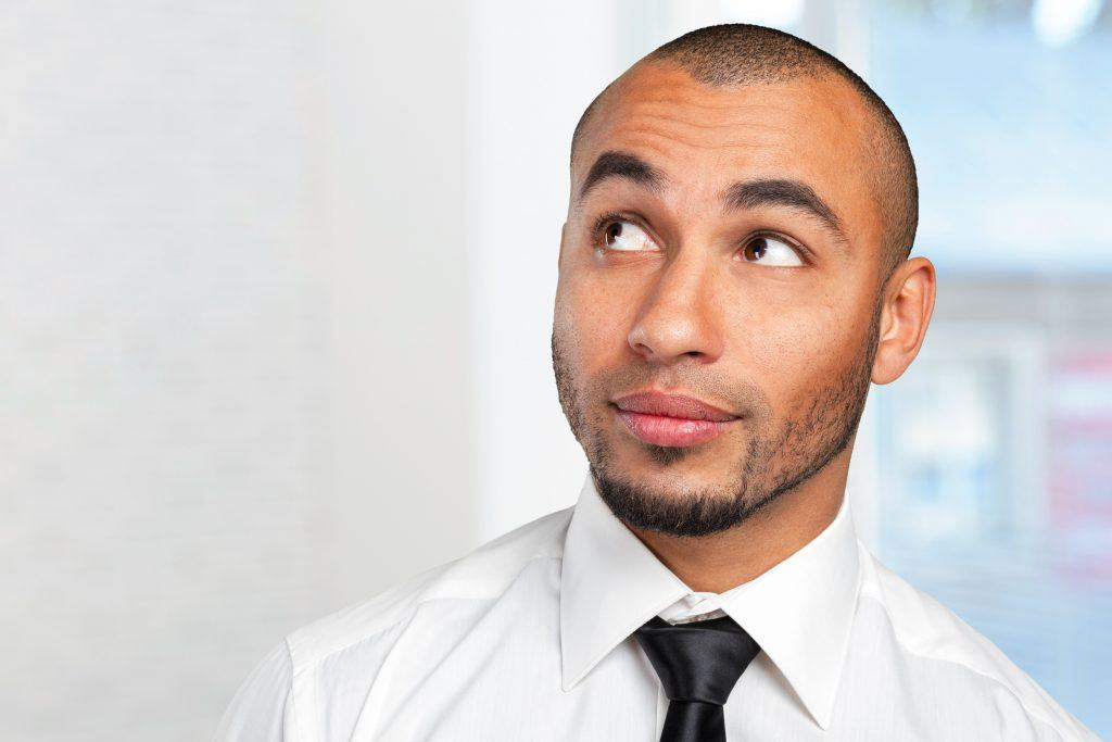 buzz cut hairstyle: man with a nearly shaved head