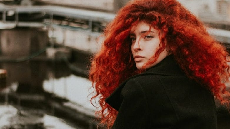 woman with a curly long red hair