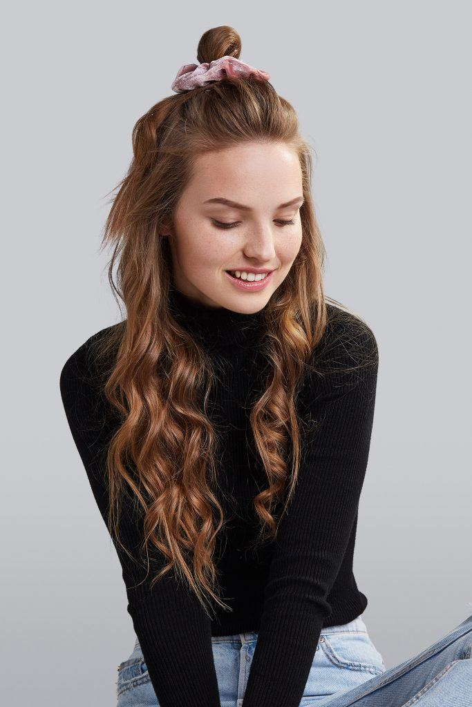 woman with half-up hairstyle