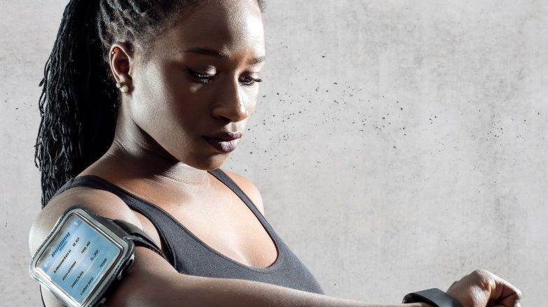 woman with protective hairstyle wearing gym workout clothing