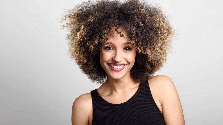 blonde with highlights: woman with curly hair