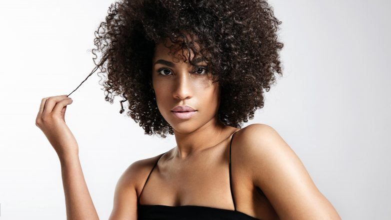 deep condition your hair: woman with full afro hairstyle