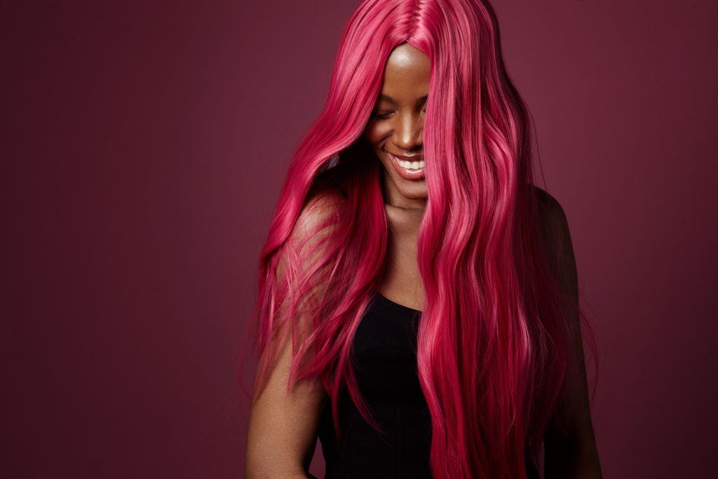 vibrant hair: black woman with hot pink dyed hair