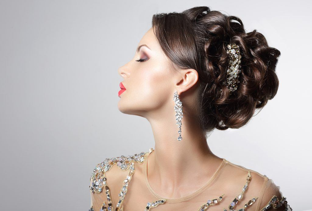 Woman wearing a NYE hairstyle with rhinestone hair accessories
