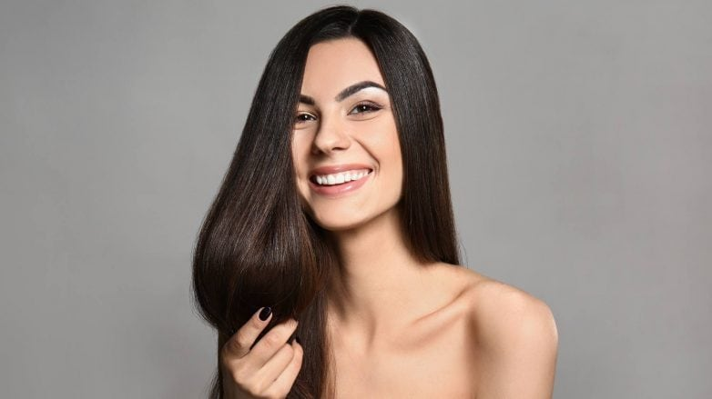 keratin smoothing treatments: woman with long silky brown hair