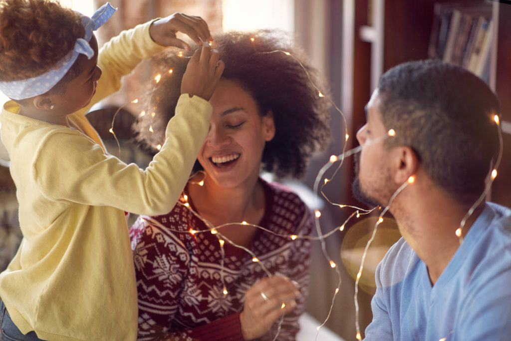 family festive haircare tips: family with festive lights