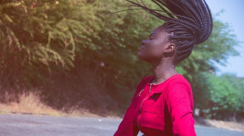 woman wearing a protective braids for windy weather