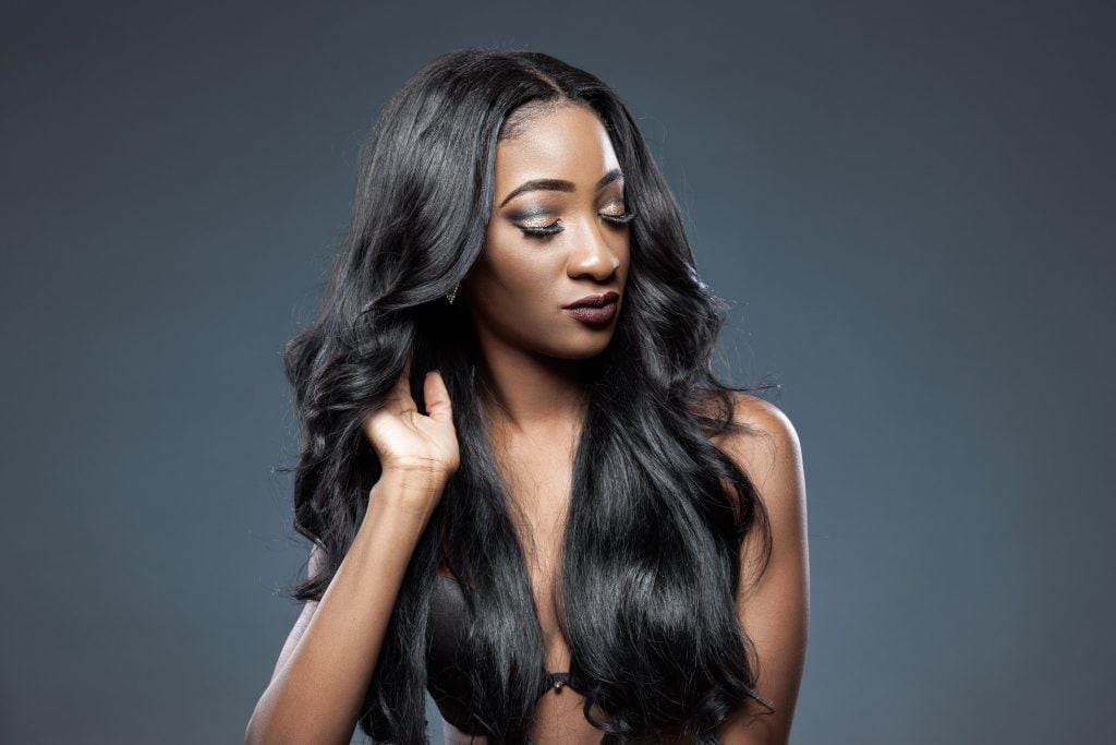 Black woman with long hair with soft bends
