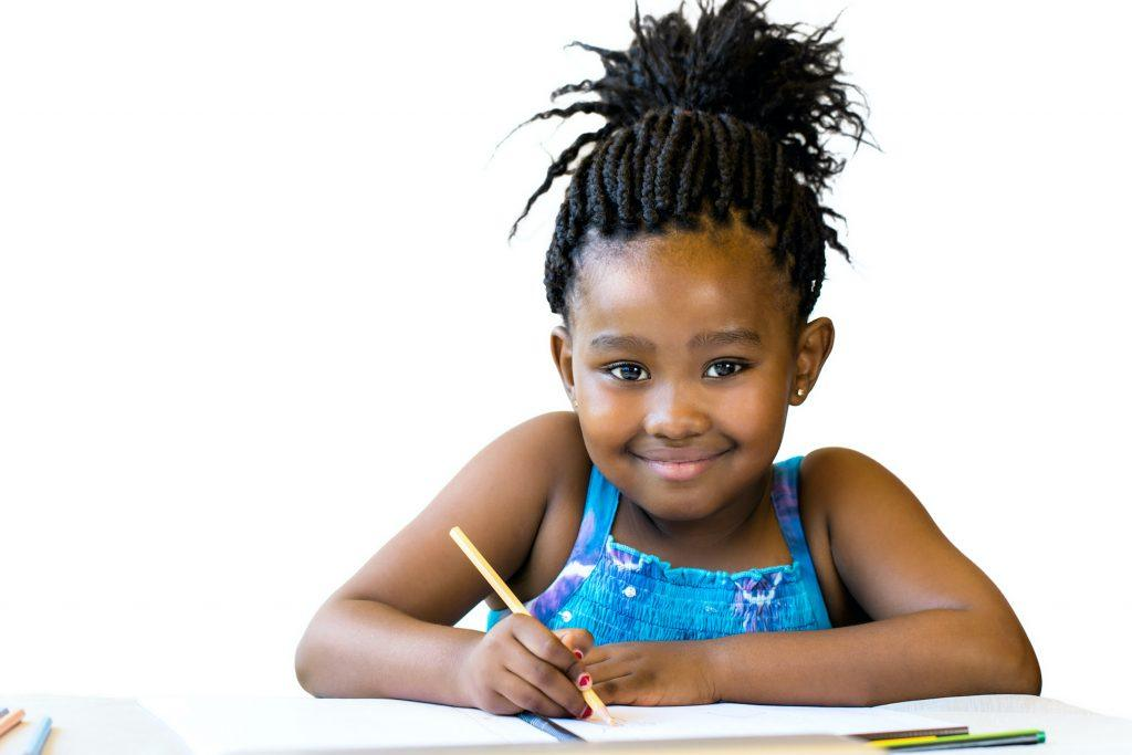 littel girl with braided ponytail school hairstyle
