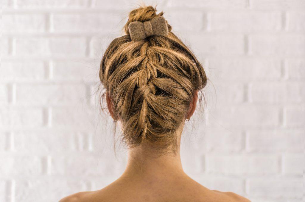 woman with an upside down braid as a work haisrtyle