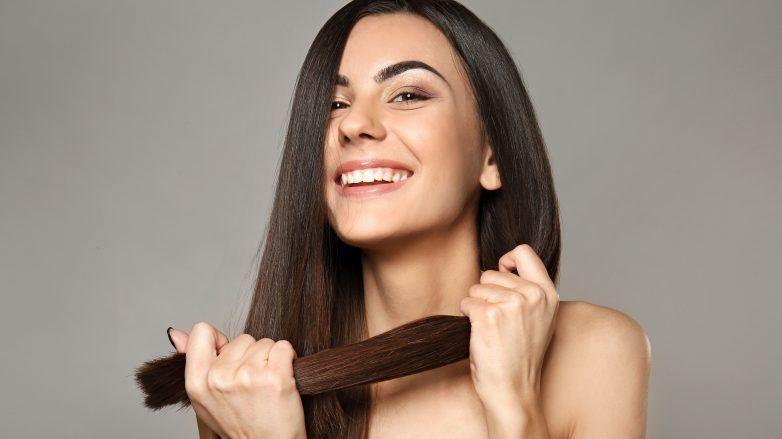 woman holding her hair, Revitalise hair