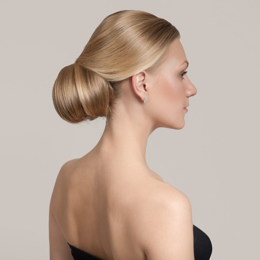 Woman with blonde hair wearing a chignon updo