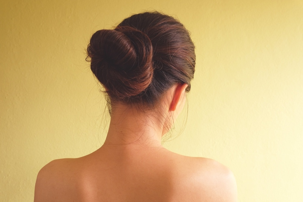 Woman with a sleek low bun hairstyle
