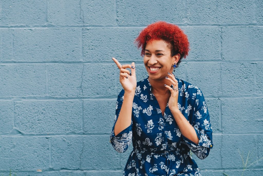 Woman with short red Aries inspired hair