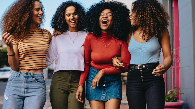 Group of curly haired women with Autumn hair colours