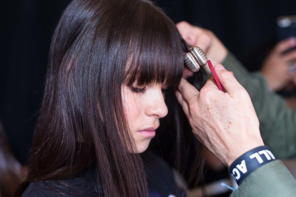 best heat protectant: flat ironing hair bangs