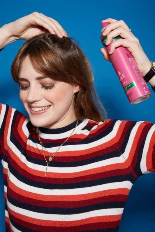 how to use dry shampoo: spray hair