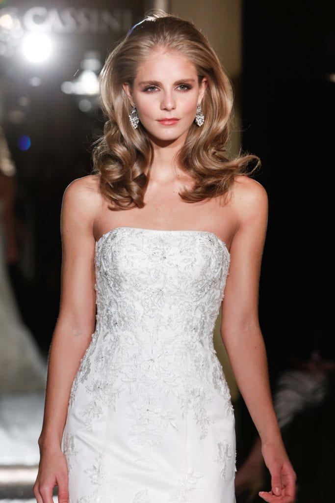 trending long hairstyles for thin hair include a blown out bombshell do