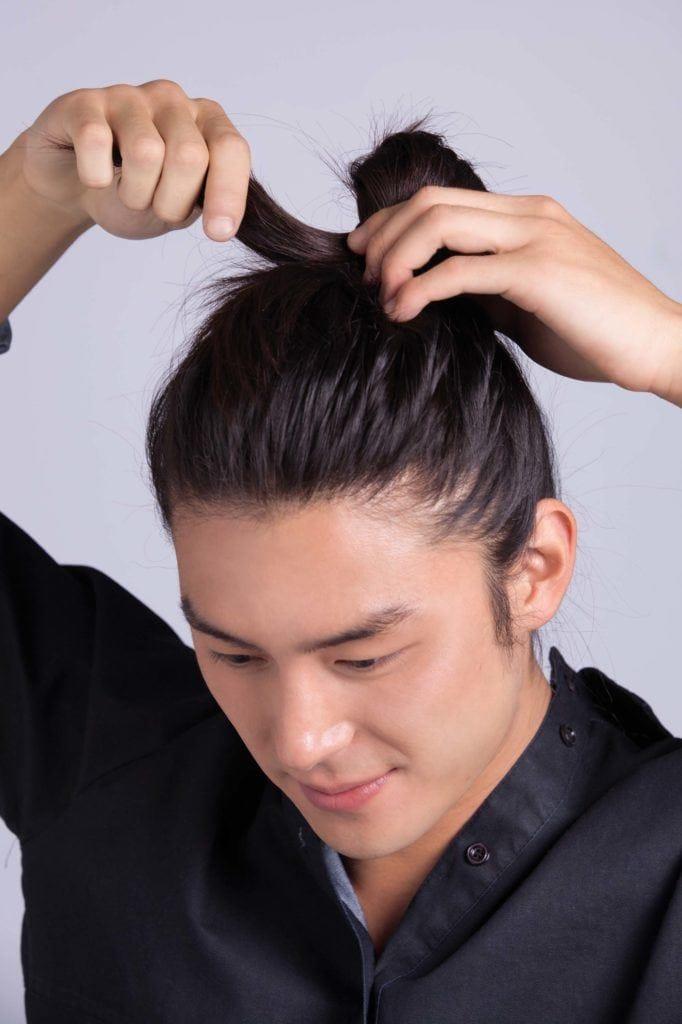 asian man creates cool hairstyles for men and man bun
