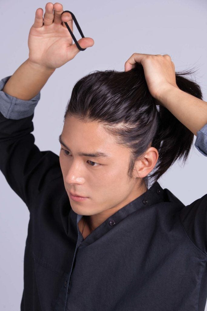 asian man creates cool hairstyles for men and ponytail