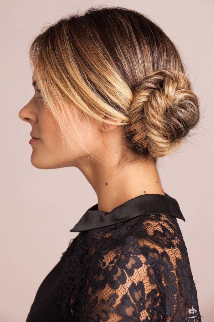 blonde woman creates side bun hairstyles and creates a chignon