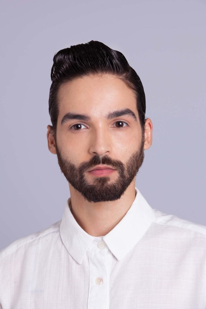 brunette man shows how to style your hair final look