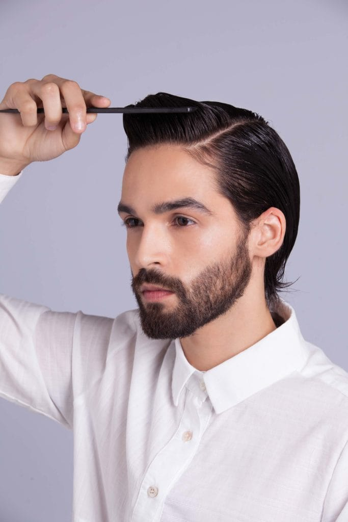 brunette man shows how to style your hair and enhances length