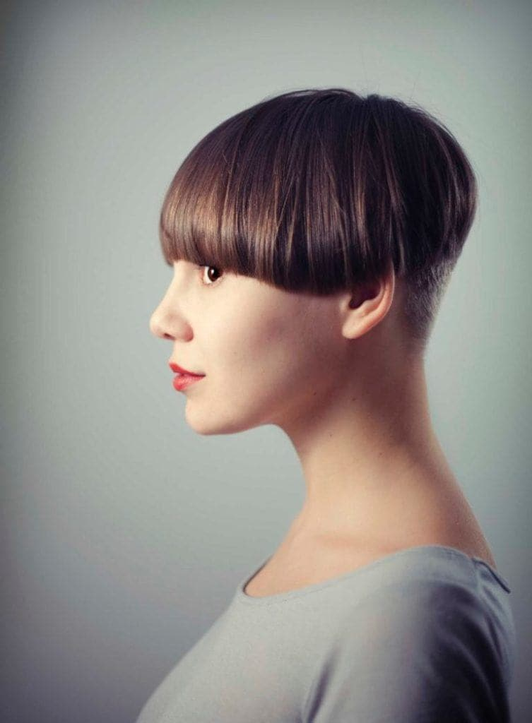 side view of a woman with sbort haircut smiling