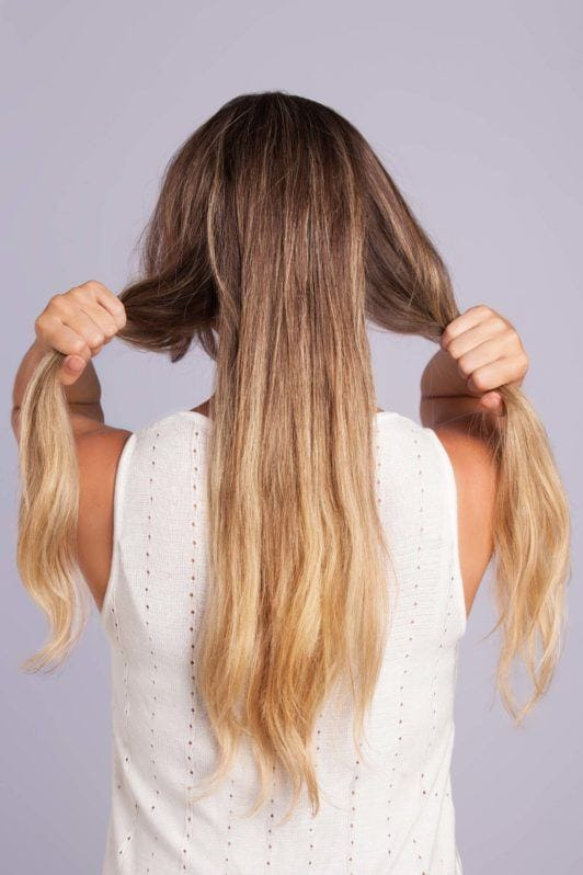Wedding Hair Buns - Step 2 - long bronde hair split into 3 sections