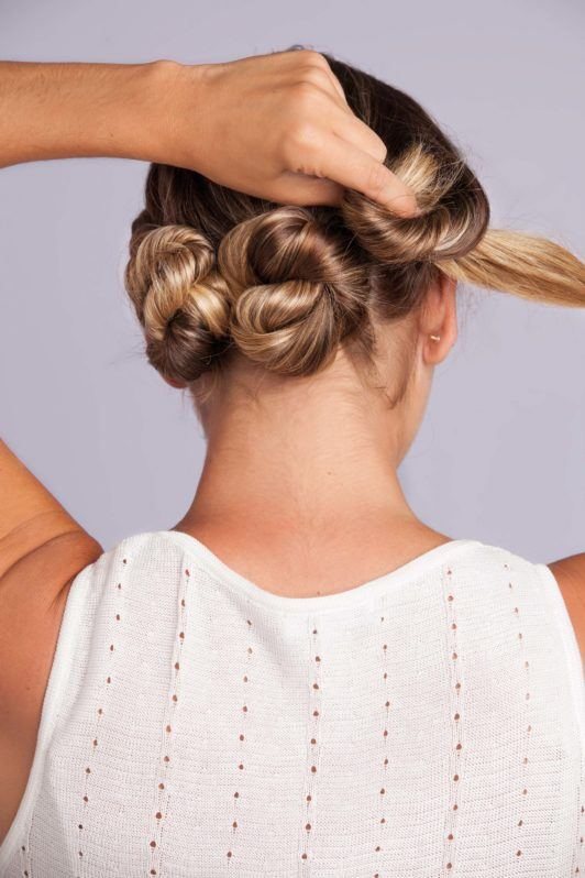 Wedding Hair Buns - Step 7 - back view with 3 twisted rolls