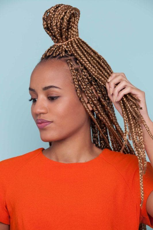 styles with box braids and a looped ponytail